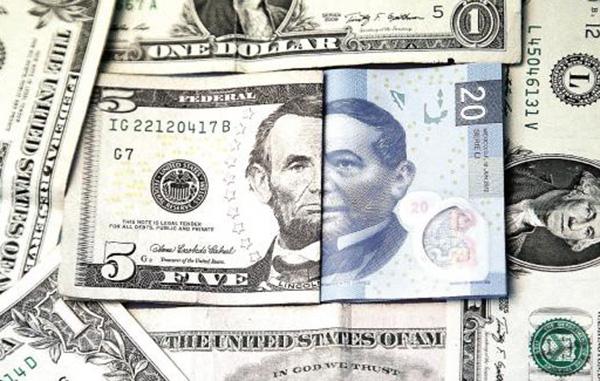Repunta dólar 20 centavos y se perfila a 21 pesos esta mañana