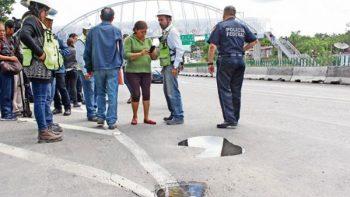 Tras bloqueo, se compromete SCT a reparar fallas del Paso Exprés